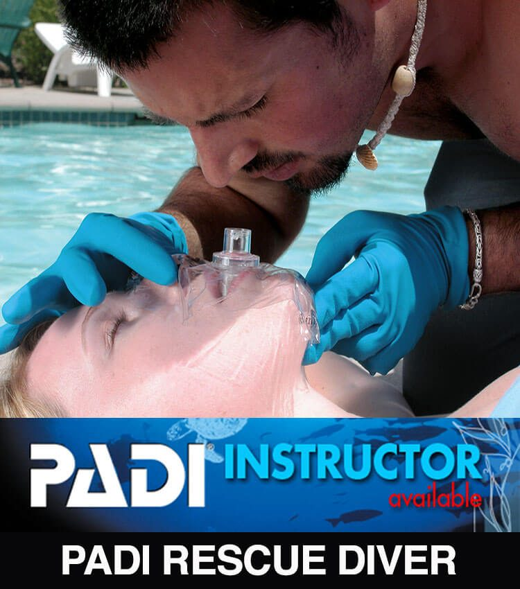 Man preparing to give rescue breaths to a girl laying on the ground next to a pool.